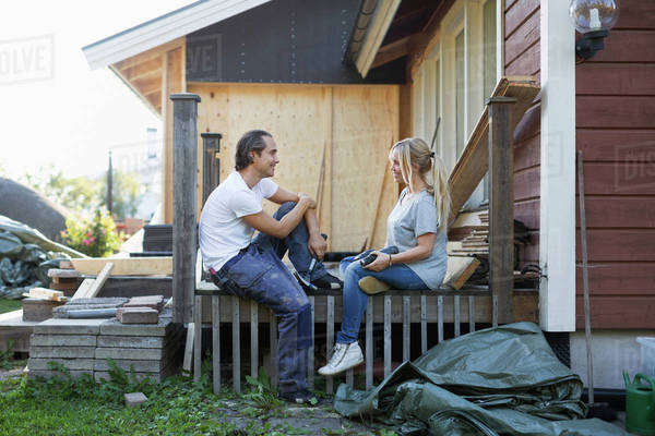 Happy couple looking at each other while renovating house Royalty-free stock photo