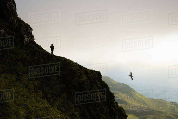 Silhouette man standing on cliff against sky Royalty-free stock photo