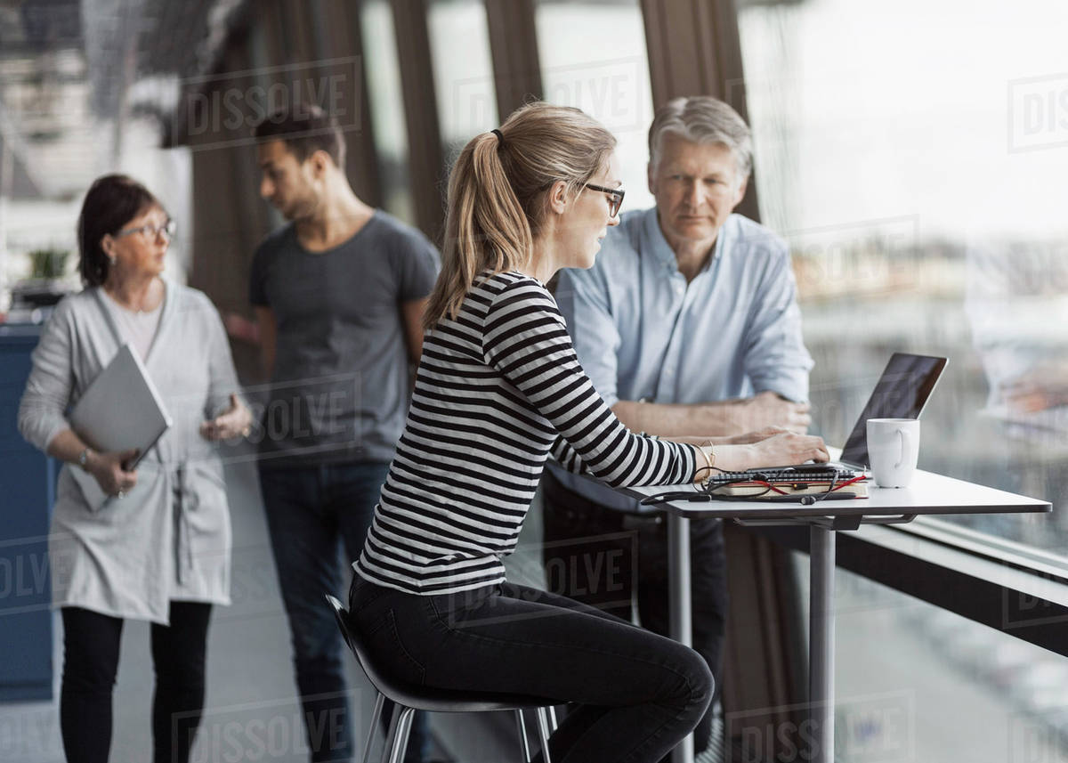 Business people working by window in office Royalty-free stock photo
