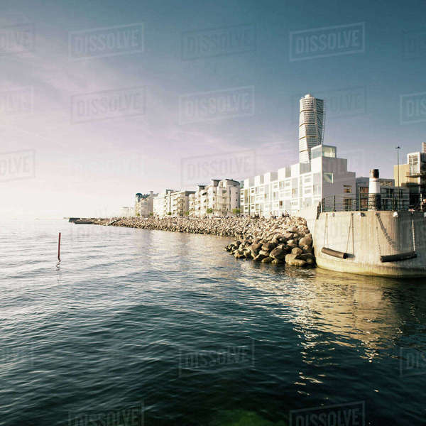 Cityscape by river against sky Royalty-free stock photo