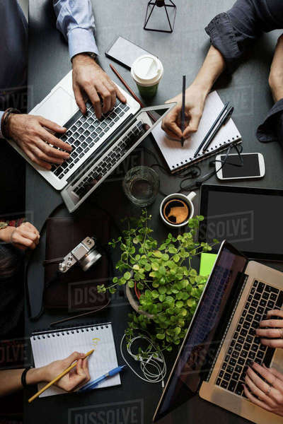 Directly above shot of business team working at table in creative office Royalty-free stock photo