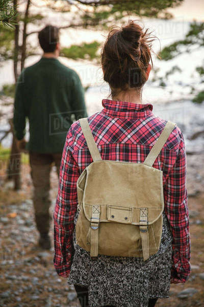 Rear view of couple hiking in forest Royalty-free stock photo