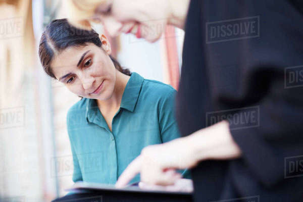 Businesswoman with female colleague using digital tablet outside office Royalty-free stock photo