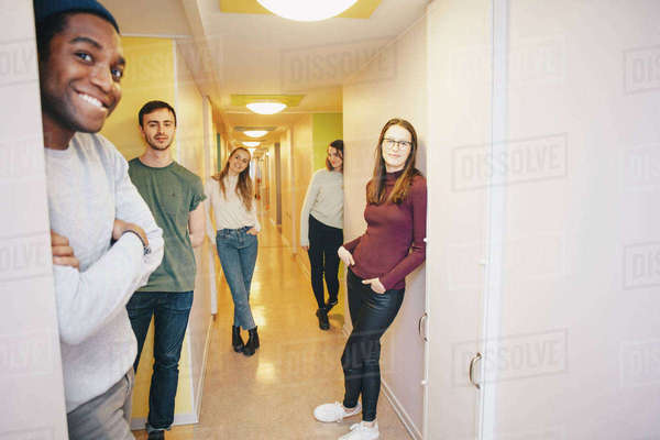 Young university students standing in dorm corridor Royalty-free stock photo
