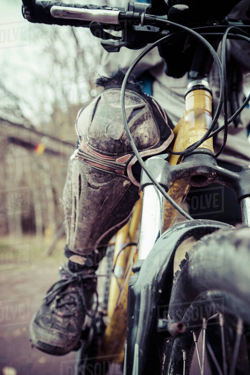 Low section of woman wearing kneepad while riding mountain bike Royalty-free stock photo