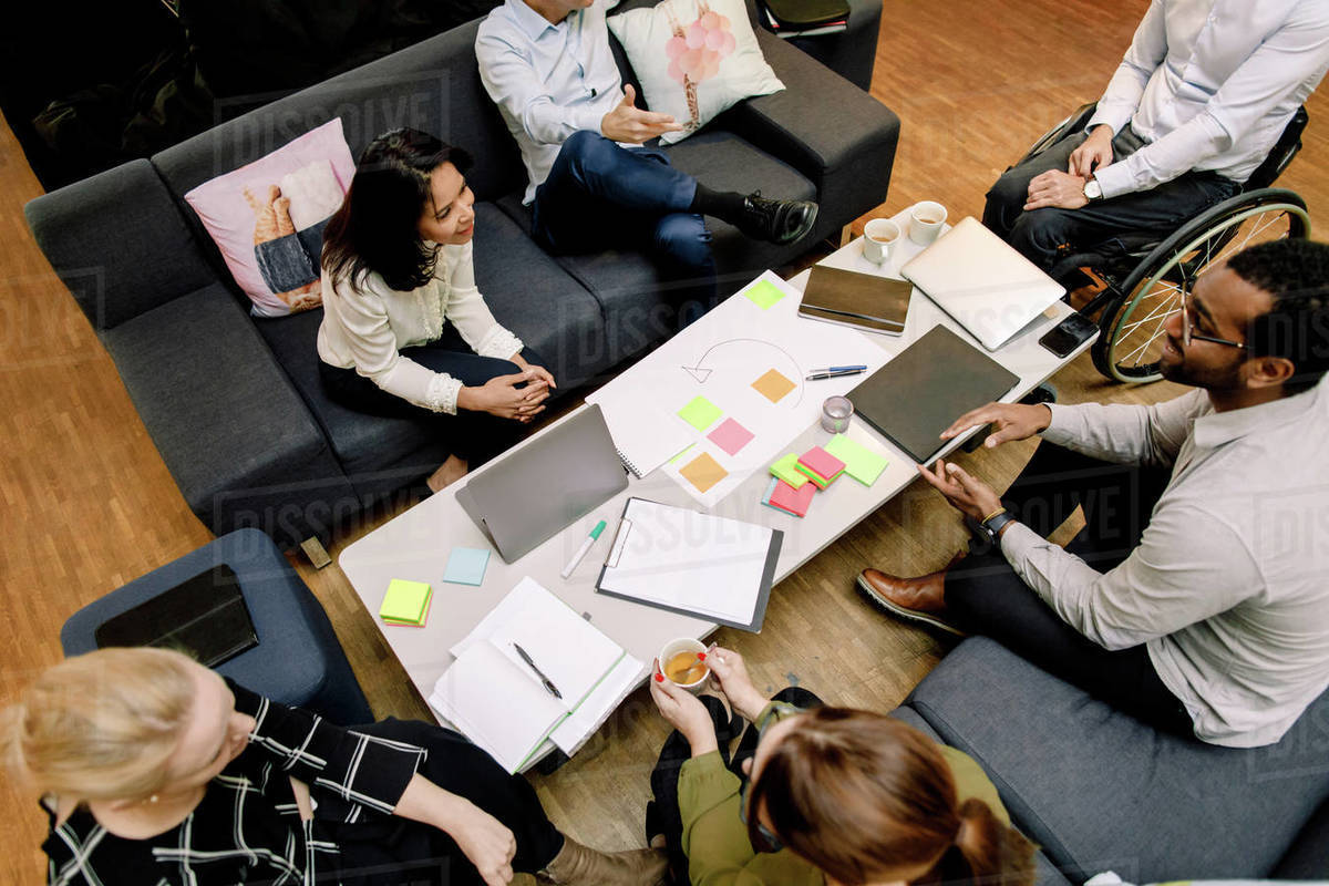 High angle view of sales managers talking during meeting at work place Royalty-free stock photo