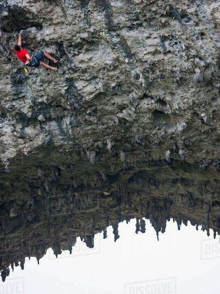 Low angle view of rock climber on Moon Hill, Yangshuo, Guangxi Zhuang, China Royalty-free stock photo