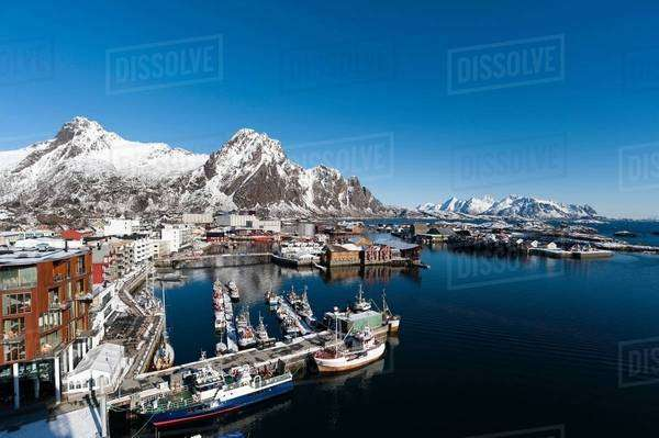 Elevated view of harbour and snow capped mountains, Svolvaer, Lofoten Islands, Norway Royalty-free stock photo
