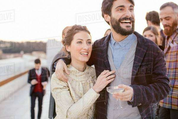 Heterosexual couple laughing together at party Royalty-free stock photo