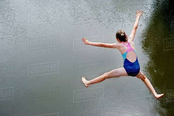 Overhead view of girl jumping into lake Royalty-free stock photo