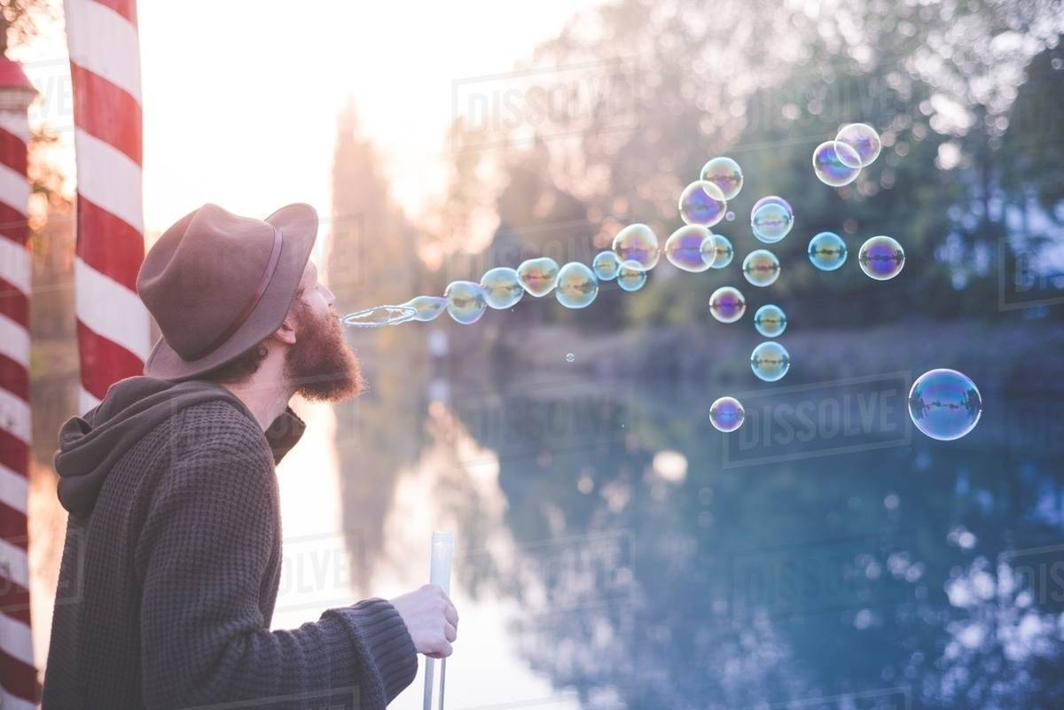 Young man blowing bubbles Royalty-free stock photo