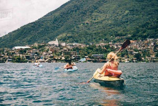 Young adult friends kayaking on  Lake Atitlan, Guatemala Royalty-free stock photo