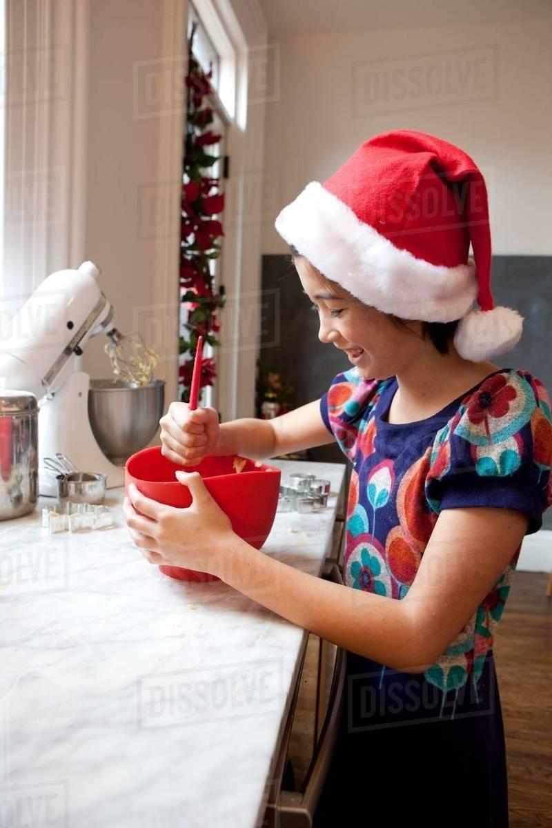 Girl In Santa Hat Making Christmas Cookies Stock Photo