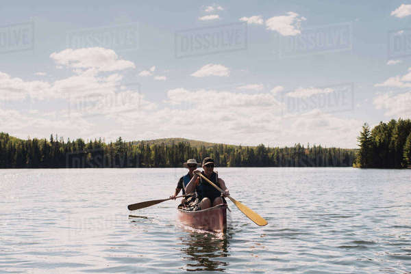 Senior couple canoeing on lake Royalty-free stock photo