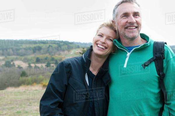 Hiking couple in rural landscape Royalty-free stock photo