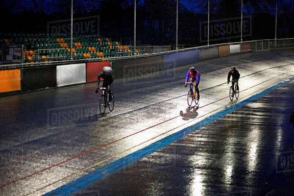 Young adult cyclists racing on velodrome track Royalty-free stock photo