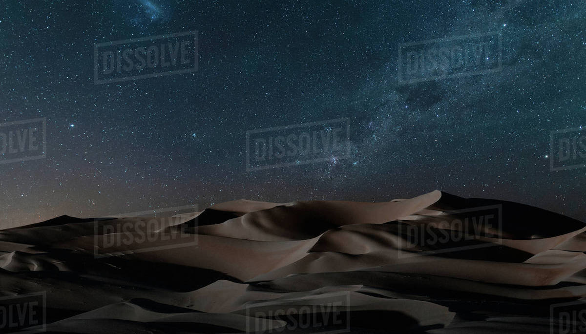 View of dunes under starry night sky, Namib Desert, Namibia stock photo