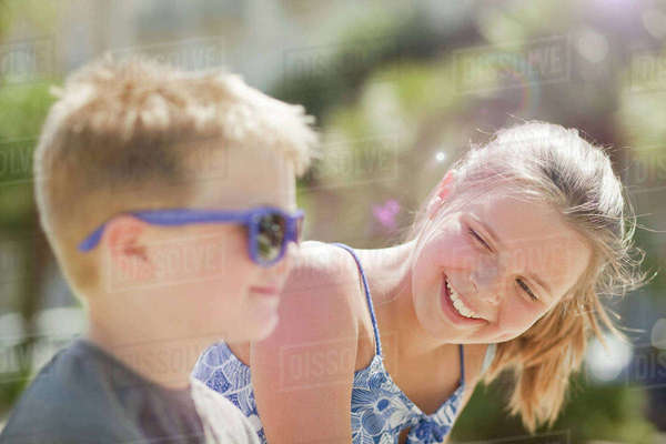 Brother and sister laughing together Royalty-free stock photo