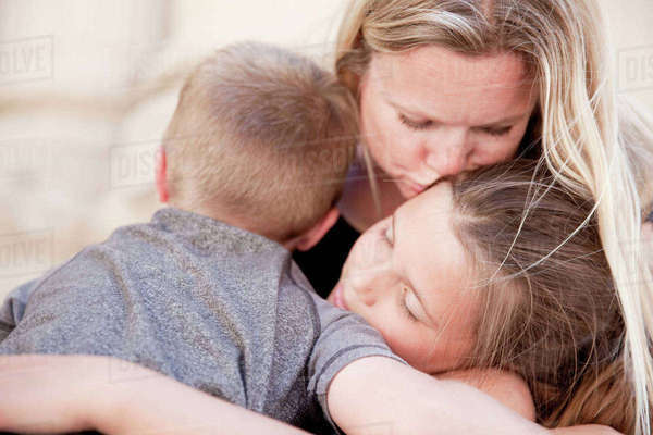 Family hugging and kissing Royalty-free stock photo