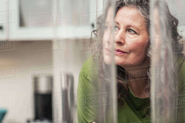 Woman daydreaming at home Royalty-free stock photo