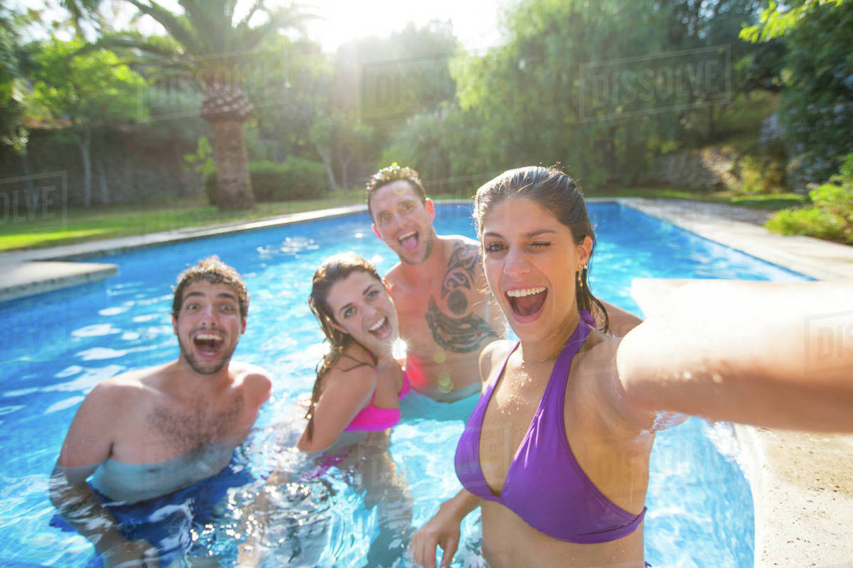 swimming pool with friends. Interesting Swimming Friends In Swimming Pool Taking Selfie On Swimming Pool With