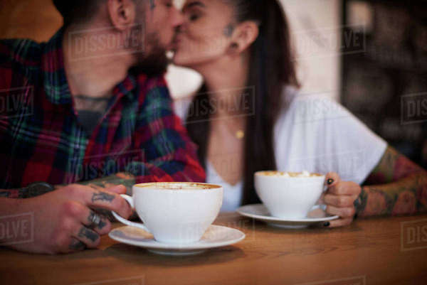 Couple kissing in cafe Royalty-free stock photo
