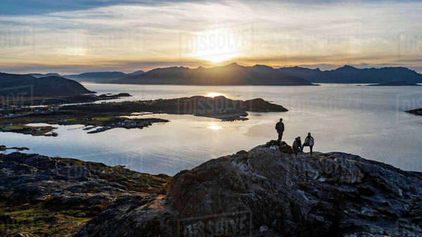 Aerial view of group of people climbing a summit on Kvaloya Island in autumn, Arctic Norway Royalty-free stock photo