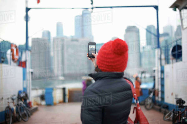 Woman photographing skyline with smartphone, Toronto, Canada Royalty-free stock photo