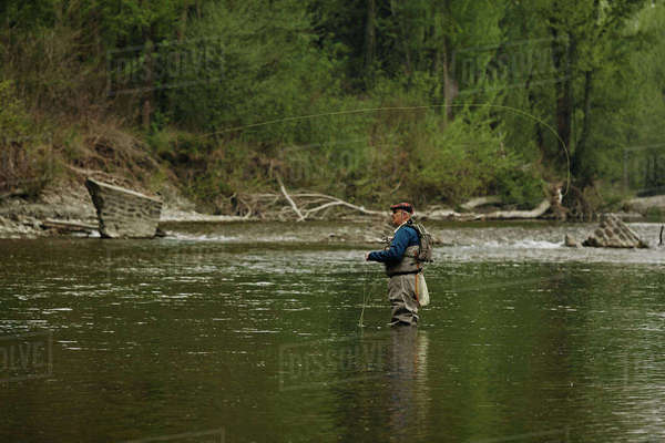 Man fishing in river Royalty-free stock photo