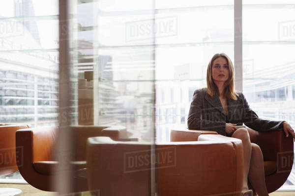 Businesswoman in coffee area in office, London, UK Royalty-free stock photo
