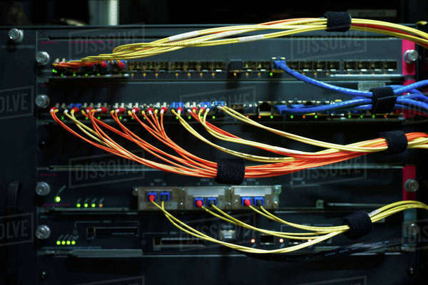 Detail of red and yellow cables on data storage equipment in data centre Royalty-free stock photo