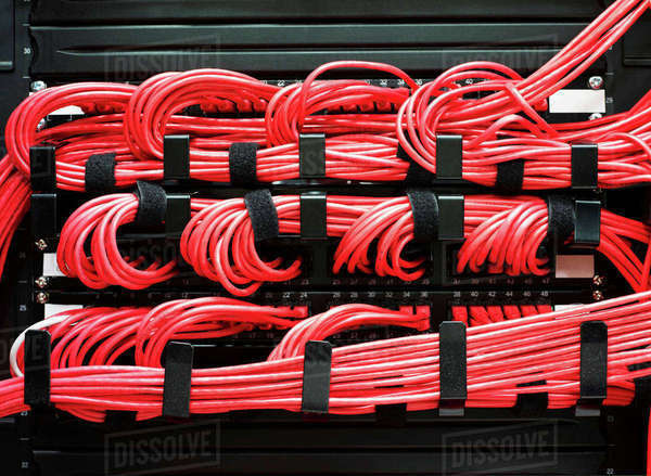 Detail of red cables on data storage equipment in data centre Royalty-free stock photo