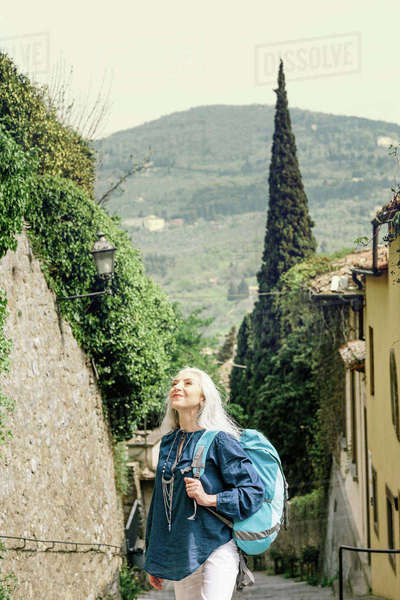 Mature woman looking up from cobbled street, Fiesole, Tuscany, Italy Royalty-free stock photo
