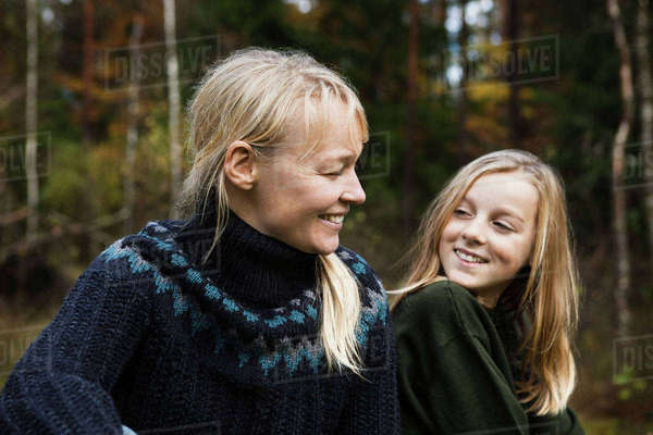 Mother and daughter smiling in forest Royalty-free stock photo