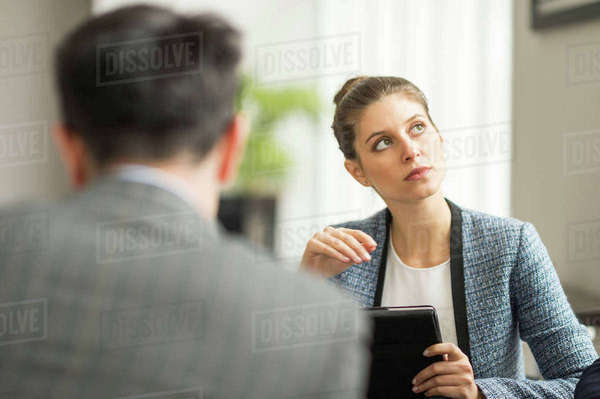 Businessman and woman in office meeting Royalty-free stock photo