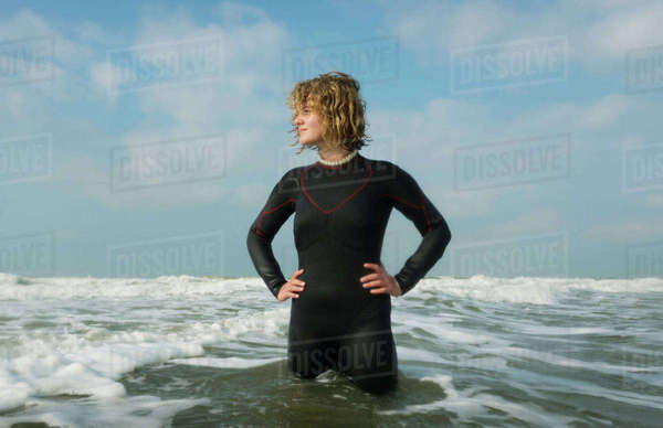 Girl standing in the North Sea wearing wetsuit Royalty-free stock photo