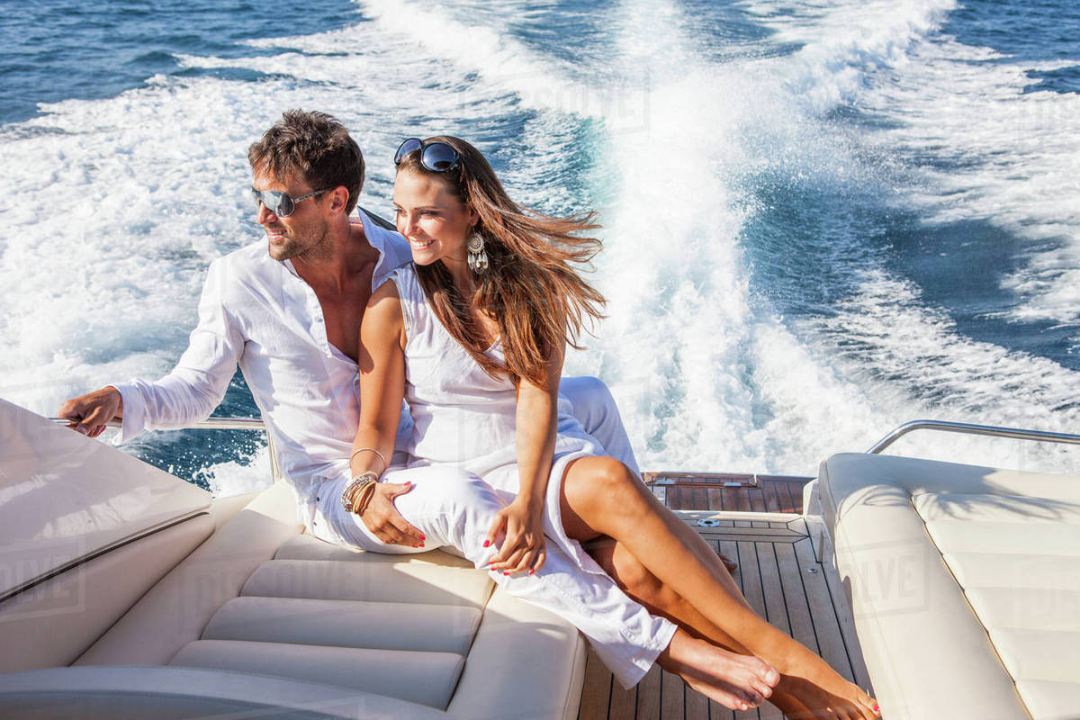 Couple relaxing on yacht, on water, looking at view - Stock Photo ...