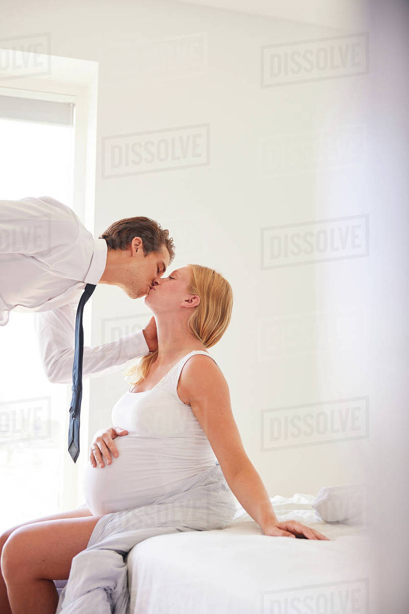 Man Is Kissing Pregnancy Belly Of His Wife Stock Image ...
