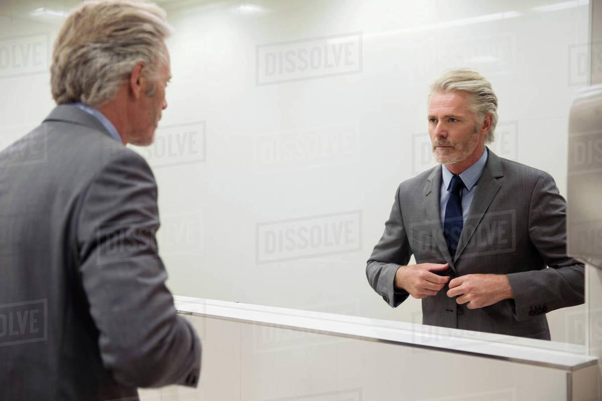 mirror image of man looking into mirror stock photo dissolve