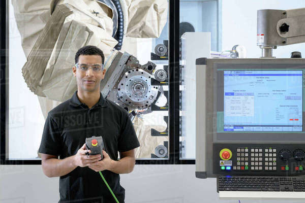 Engineer Programming Robot In Robotics Research Facility Stock
