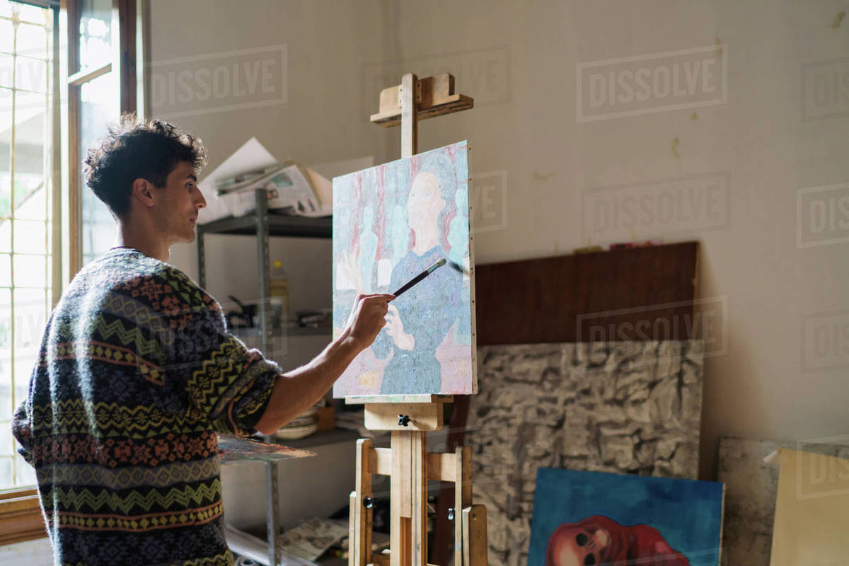 Male Artist Painting Canvas At Easel In Artists Studio Stock Photo Dissolve
