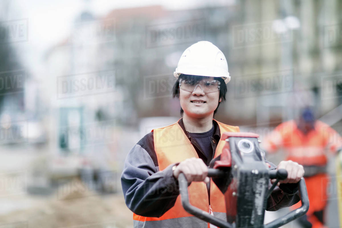 young construction worker wearing hard hat stock photo dissolve