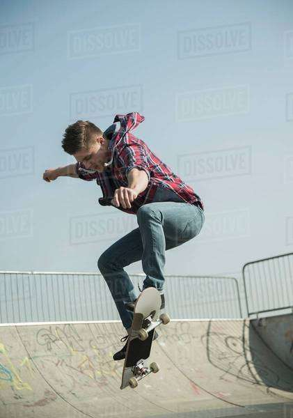 Young man doing skateboarding trick Royalty-free stock photo