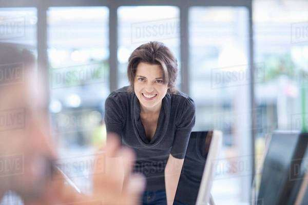 Female office worker smiling, portrait Royalty-free stock photo