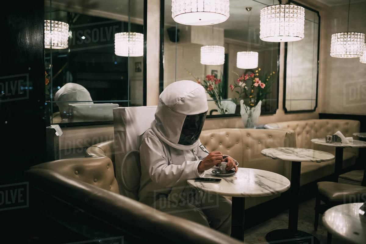 Astronaut having coffee in restaurant Royalty-free stock photo