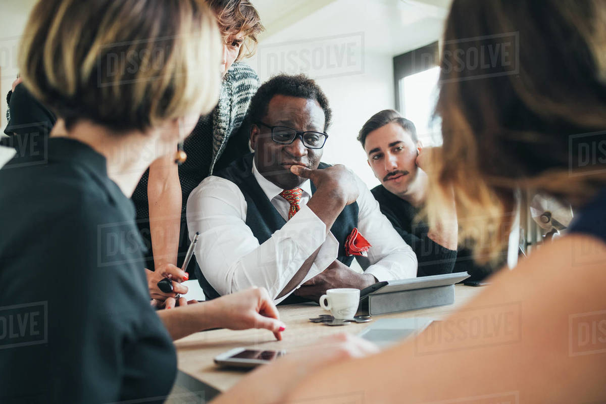 Businessmen and businesswomen having discussion in loft office Royalty-free stock photo