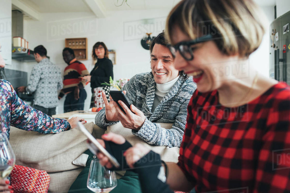 Friends using smartphone at party Royalty-free stock photo