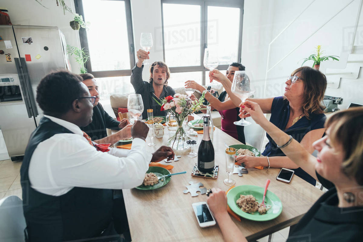 Businessmen and businesswomen celebrating at lunch party in loft office Royalty-free stock photo