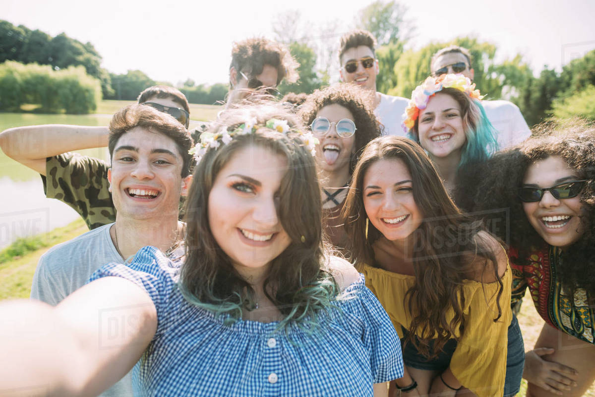 Group of friends taking selfie in park Royalty-free stock photo