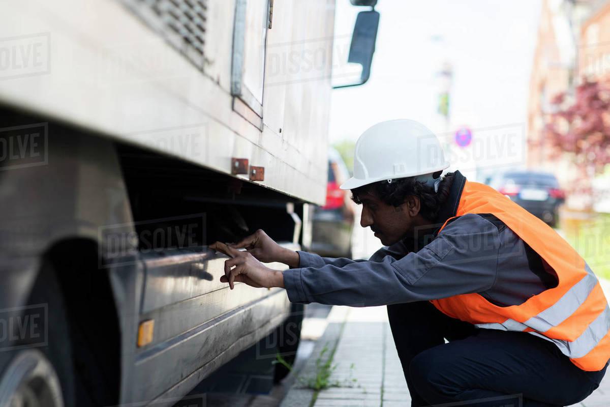 Male engineer looking beneath truck Royalty-free stock photo
